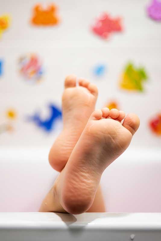 baby-in-the-bathroom-detail-of-cute-wet-feet-2.jpg